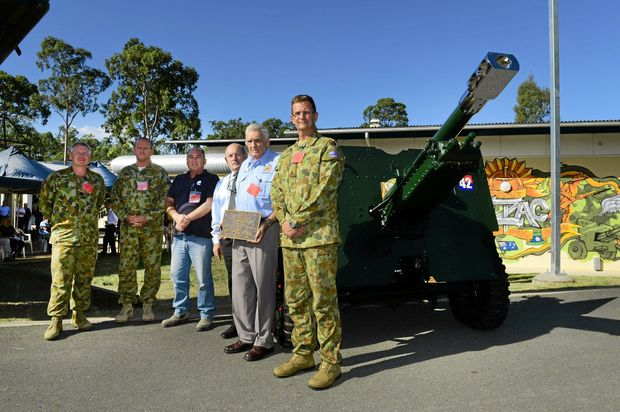 TREASURED: Ipswich RSL sub branch president Phil Gilbert accepts the gun from East Coast Apprenticeships and members of the Royal Australian Artillery's 1st Regiment.